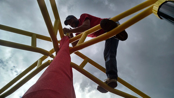 Man Working on Playground Equipment