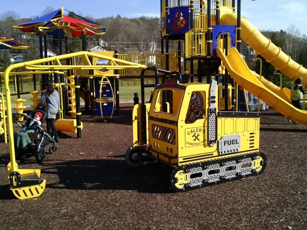 playground with yellow bulldozer play feature