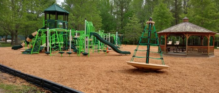 green playground on mulch area