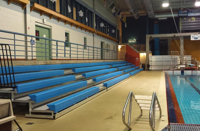 5 rows of bleachers next to a pool