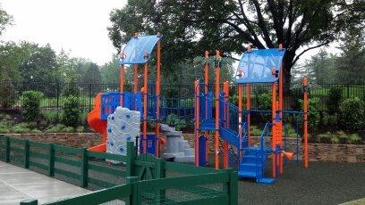 blue and orange playground on mulch