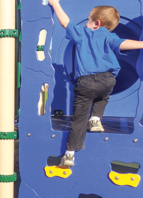 boy climbing on playground