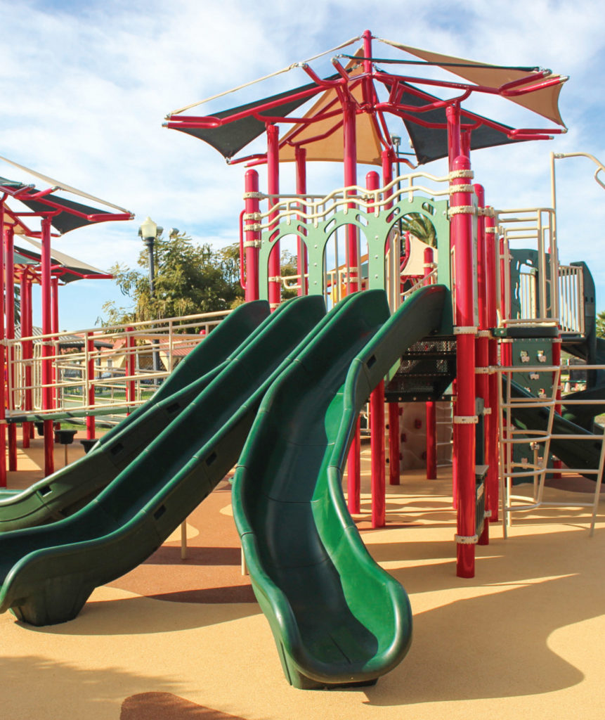 three slide playground with sunshade