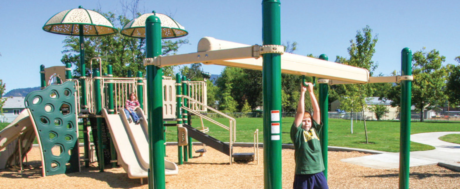 boy and girl playing on large playground
