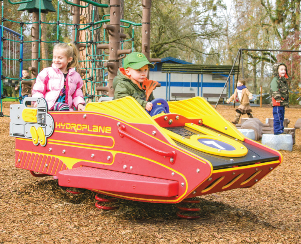 small children in plane shaped playground accessory