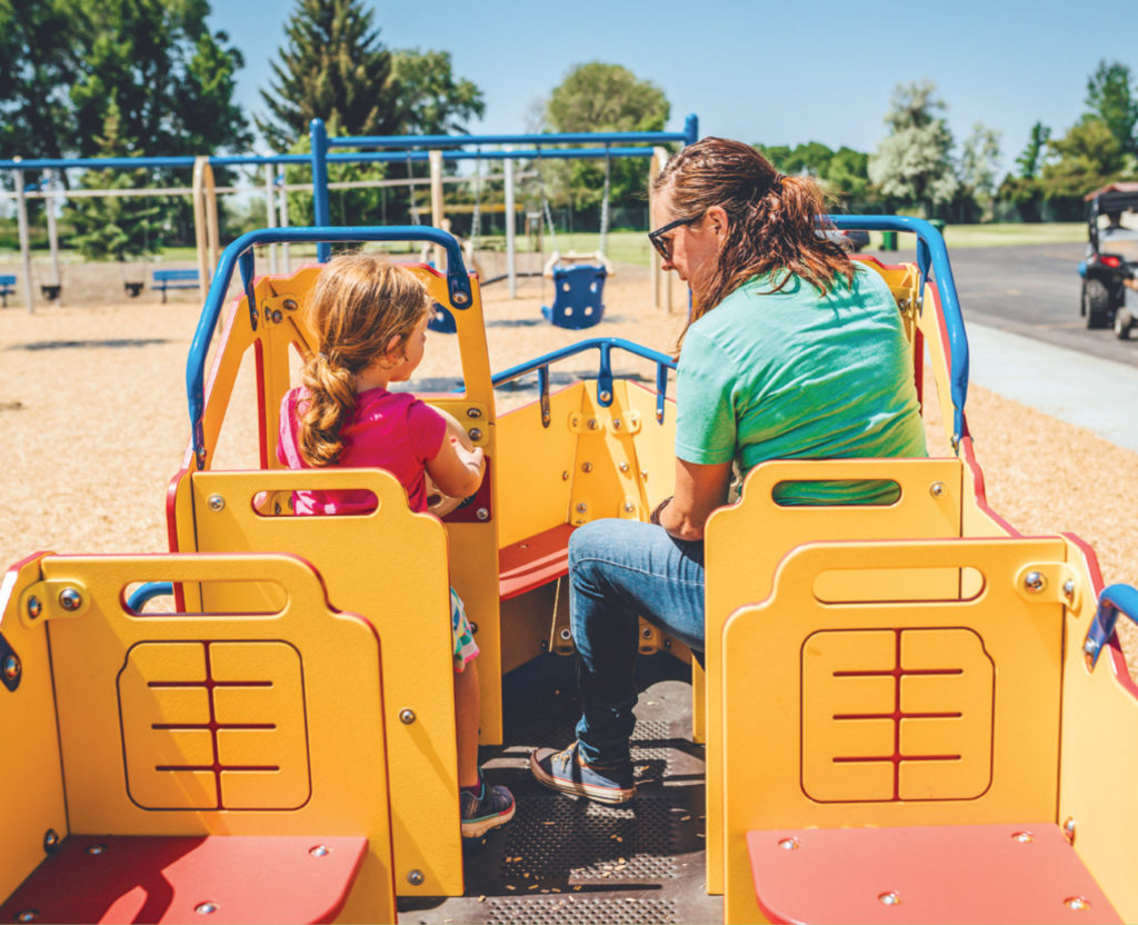 mom and daughter on playground at the park