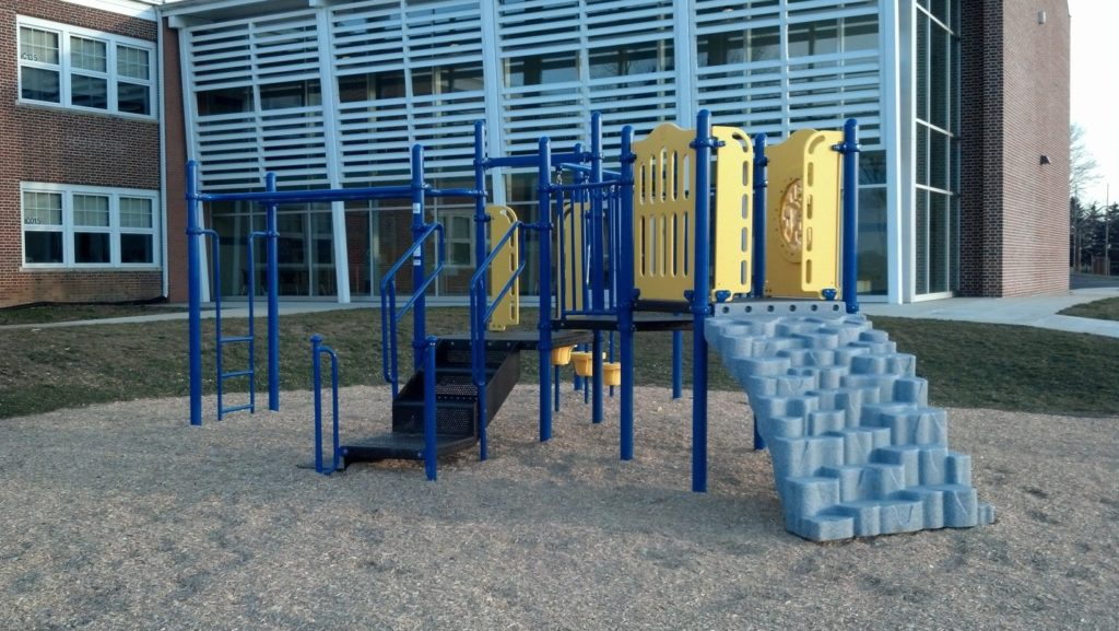 blue and yellow playground behind school