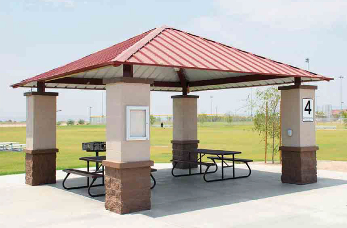 pavilion over two picnic tables on cemented platform