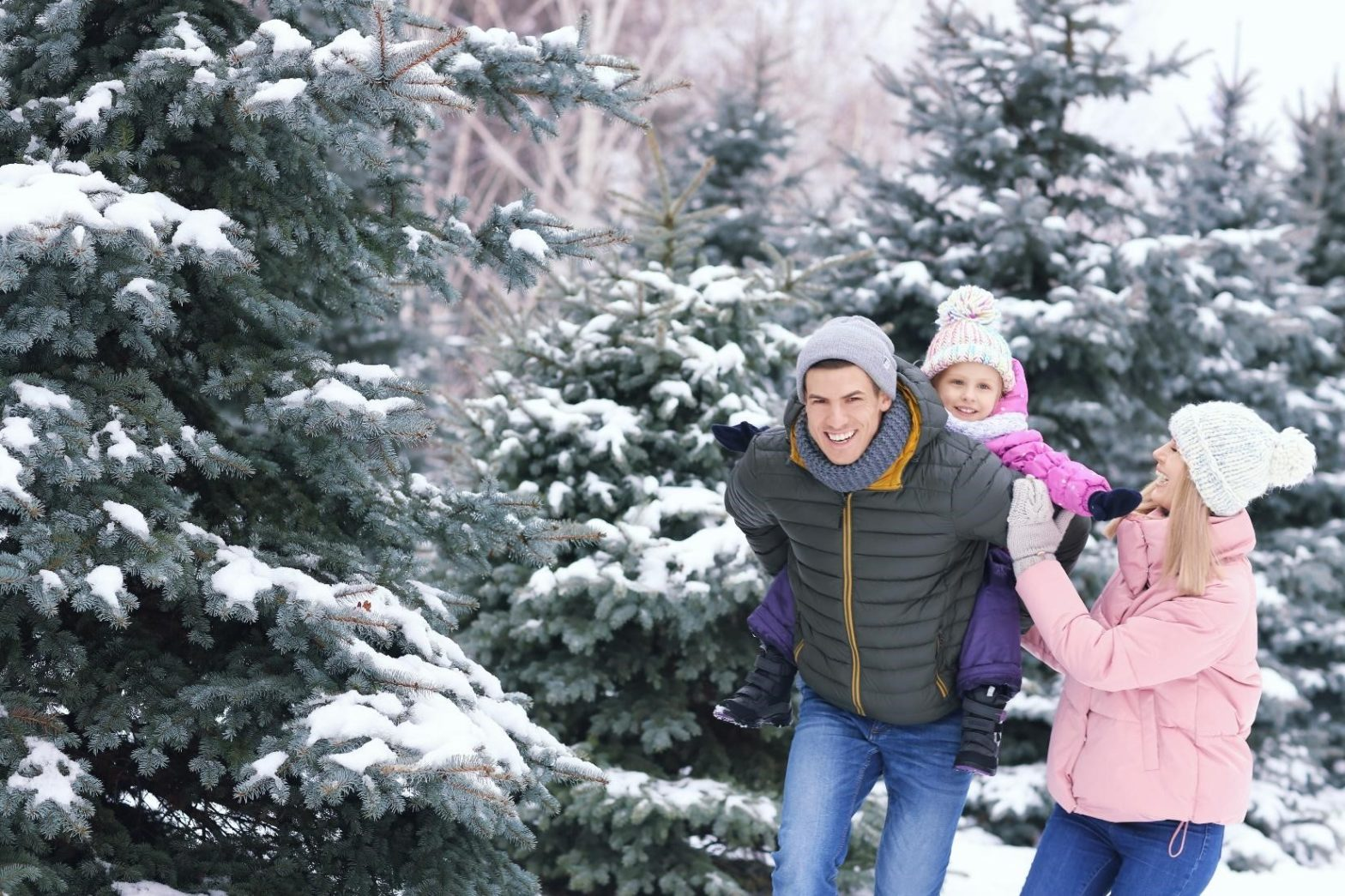Family playing in snowy woods